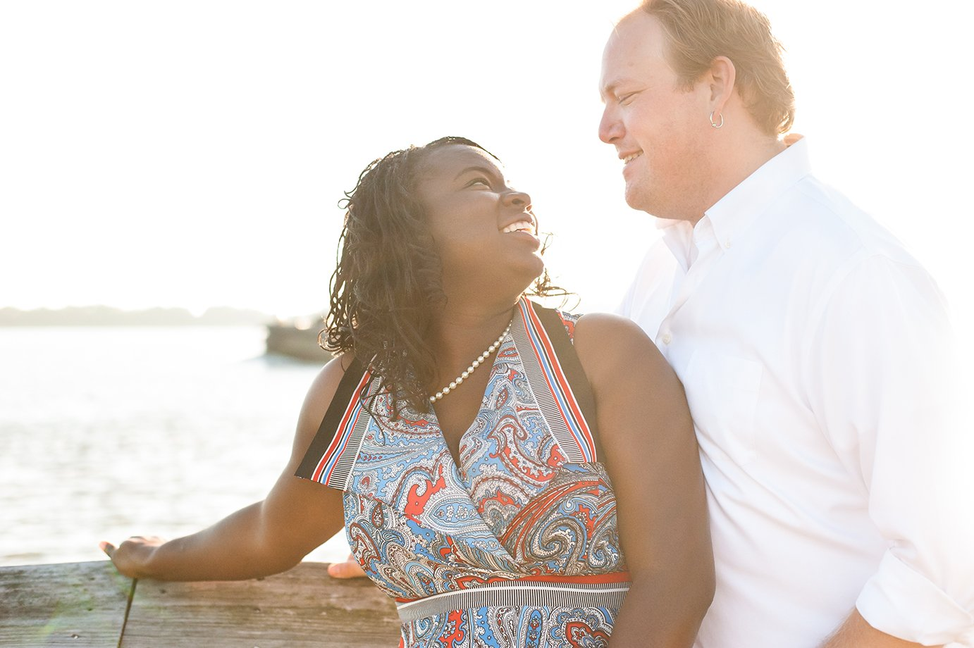 Engaged couple at Riverfront Park in Charleston SC in golden early morning sun