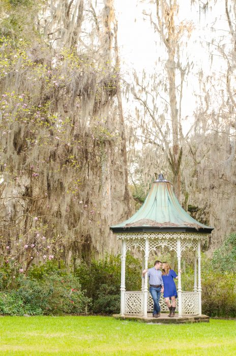 Couple in gazebo at Magnolia Plantation in Charleston, SC during their engagement photography session