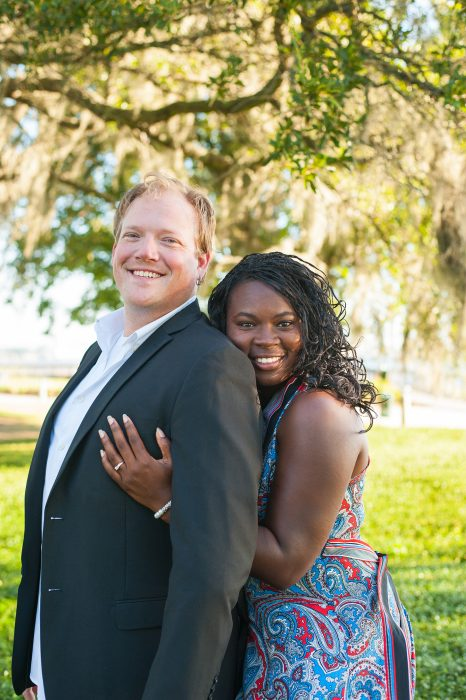 engaged couple posing during engagement photography session at riverfront park in charleston sc
