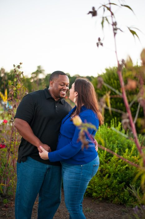 A married couple poses for portraits at Riverfront Park in North Charleston, SC