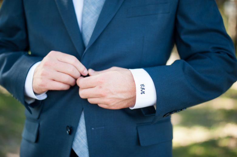 Photo of charleston groom in blue suit monogrammed sleeve