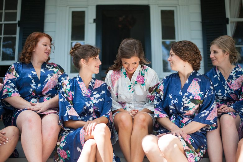 Bride-bridesmaids-laughing-wedding-photo-getting-ready-robes