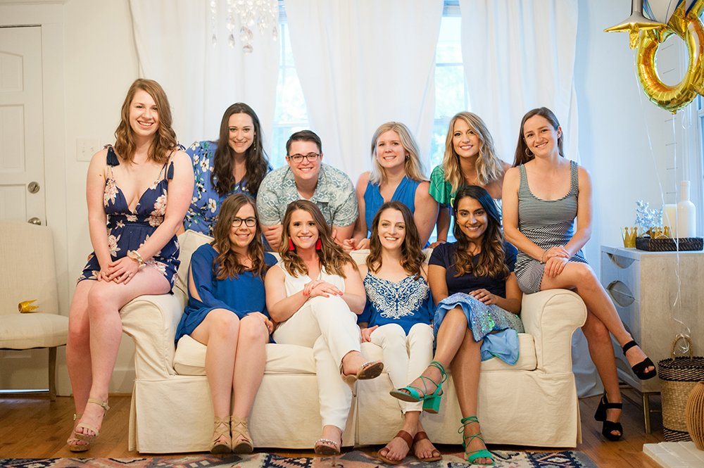 bridal party on couch at downtown charleston bachelorette party
