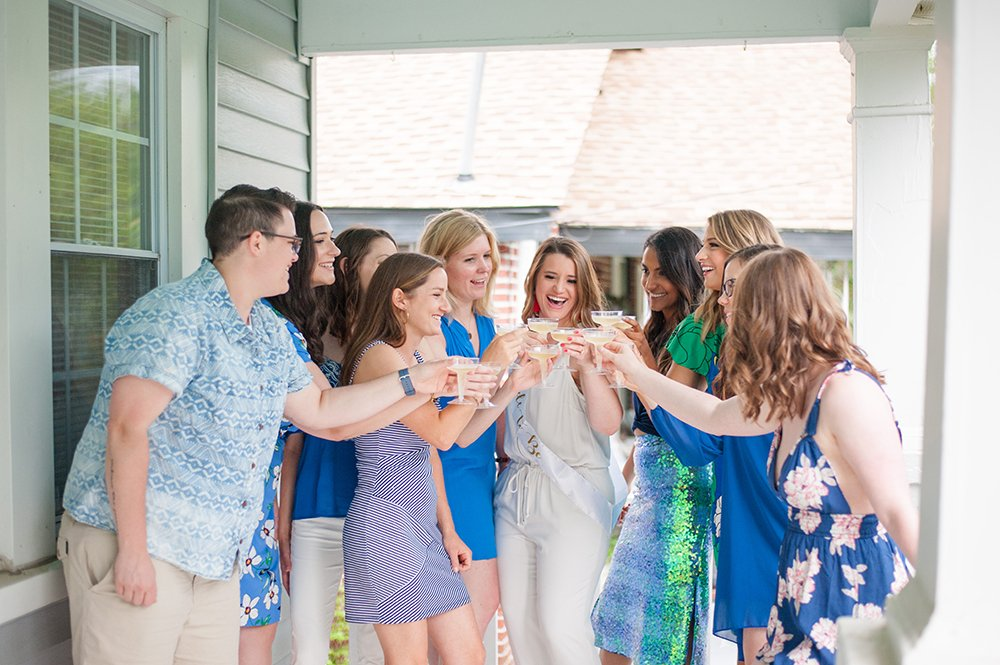 downtown charleston bachelorette party cheers on porch
