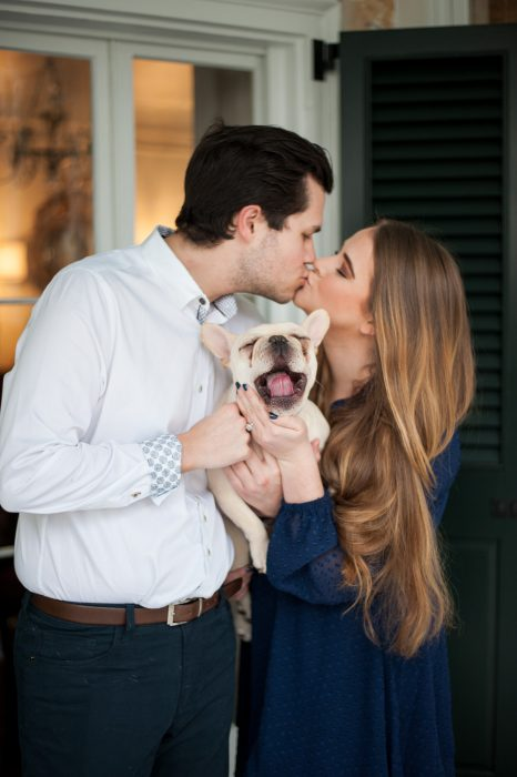 Couple with frenchie yawning in downtown Charleston before Hampton Park engagement session
