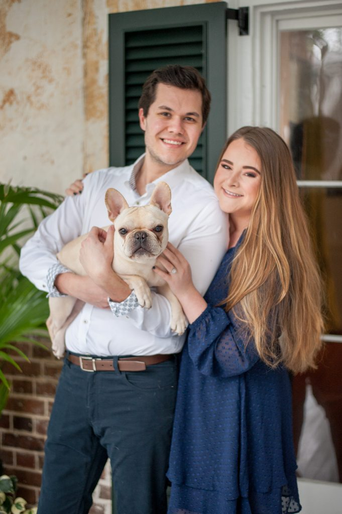Couple with frenchie in downtown Charleston before Hampton Park engagement session
