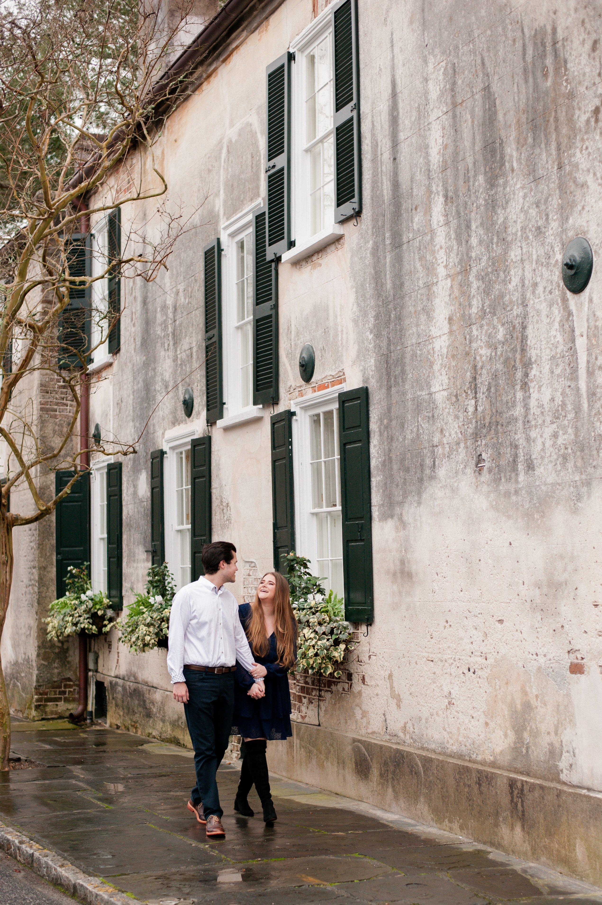 Couple in downtown Charleston before Hampton Park Engagement session