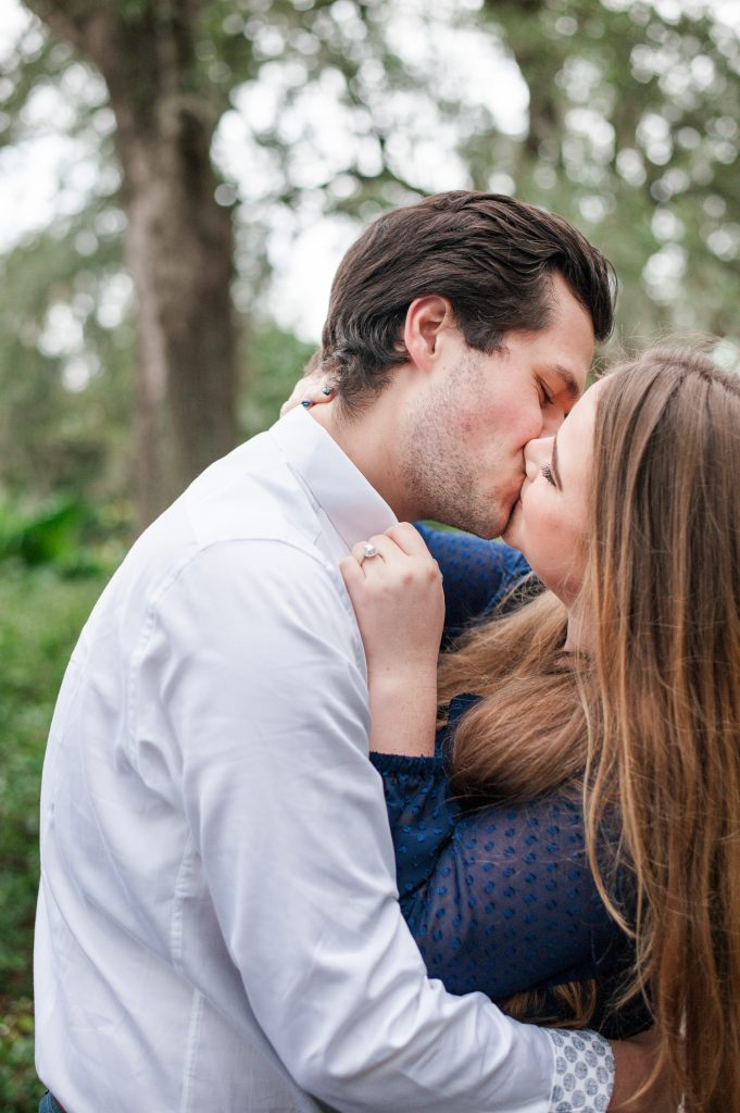 Couple under avenue of oaks at Hampton Park engagement session in Charleston, SC