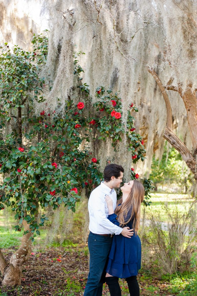Couple under tree at Hampton Park engagement session in Charleston, SC