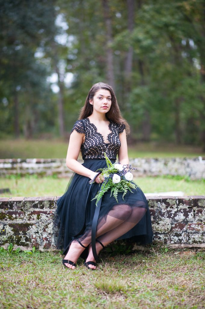 Girl sitting on brick at Colonial Dorchester State Historic Site during Halloween photo session