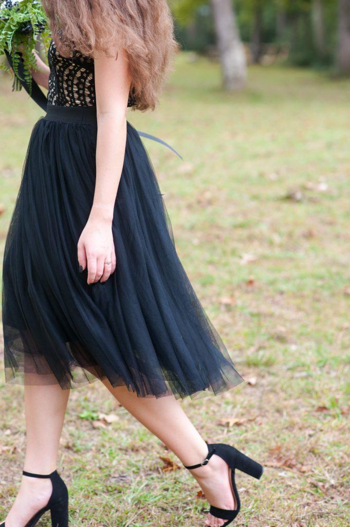 Girl walking by in black tulle skirt