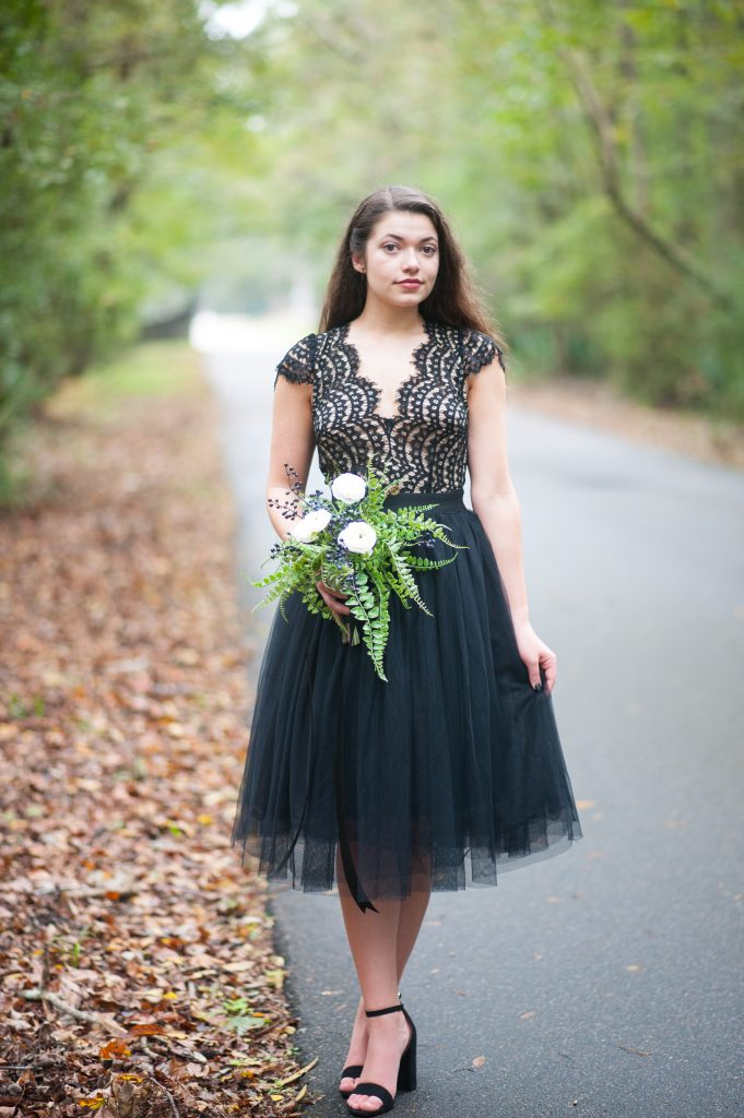 Girl in black lace dress holding bouquet. Halloween inspired photo shoot in Charleston