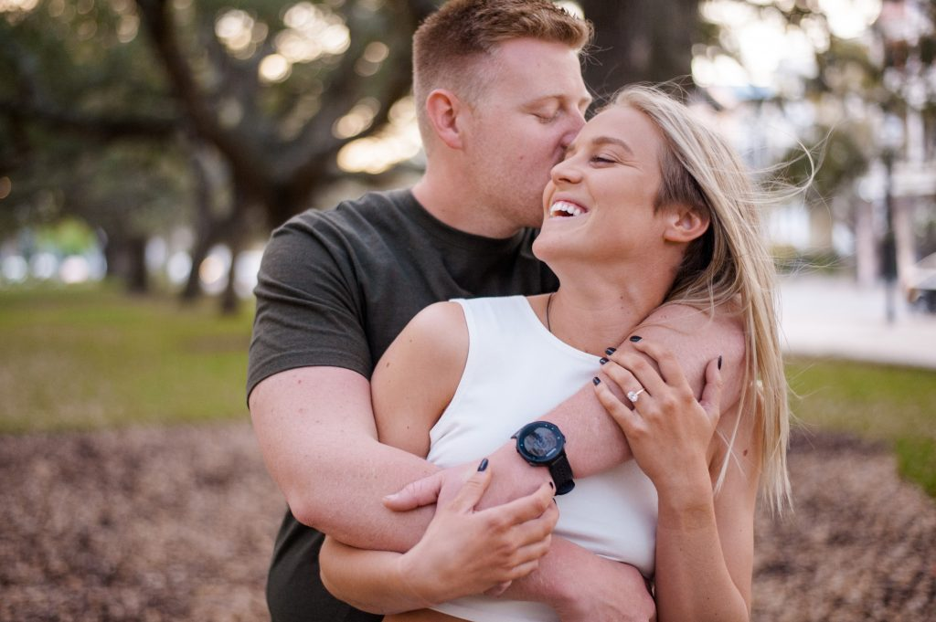 Couple in downtown Charleston during Charleston engagement photos
