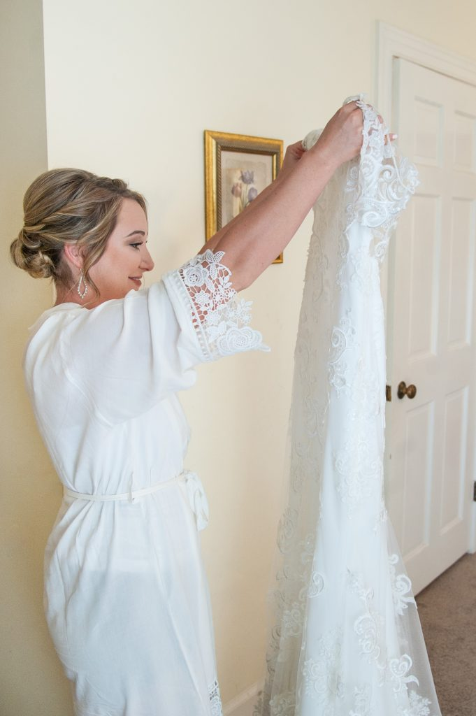 Bride admires her dress at The Island House wedding