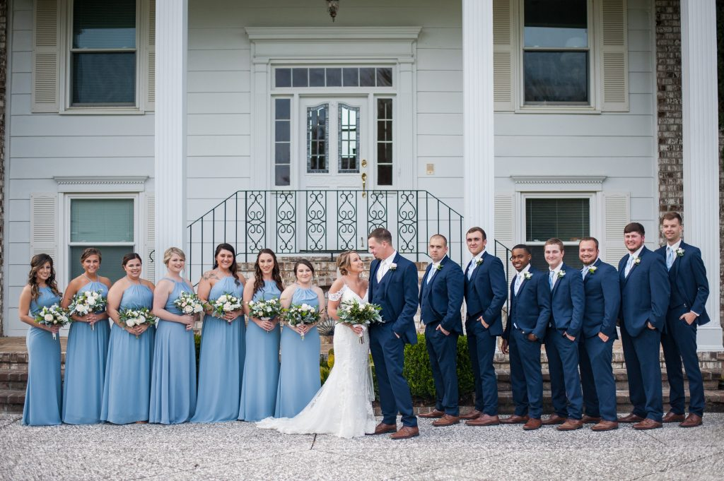 Wedding party in front of The Island House by a Charleston wedding photographer