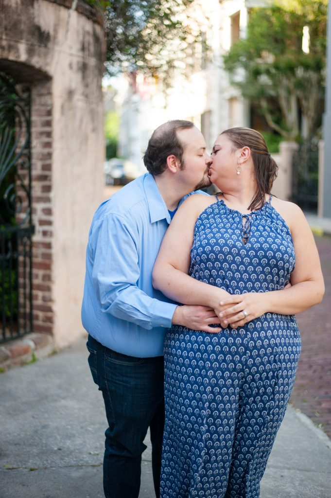 Couple posing for anniversary photos in downtown Charleston, SC