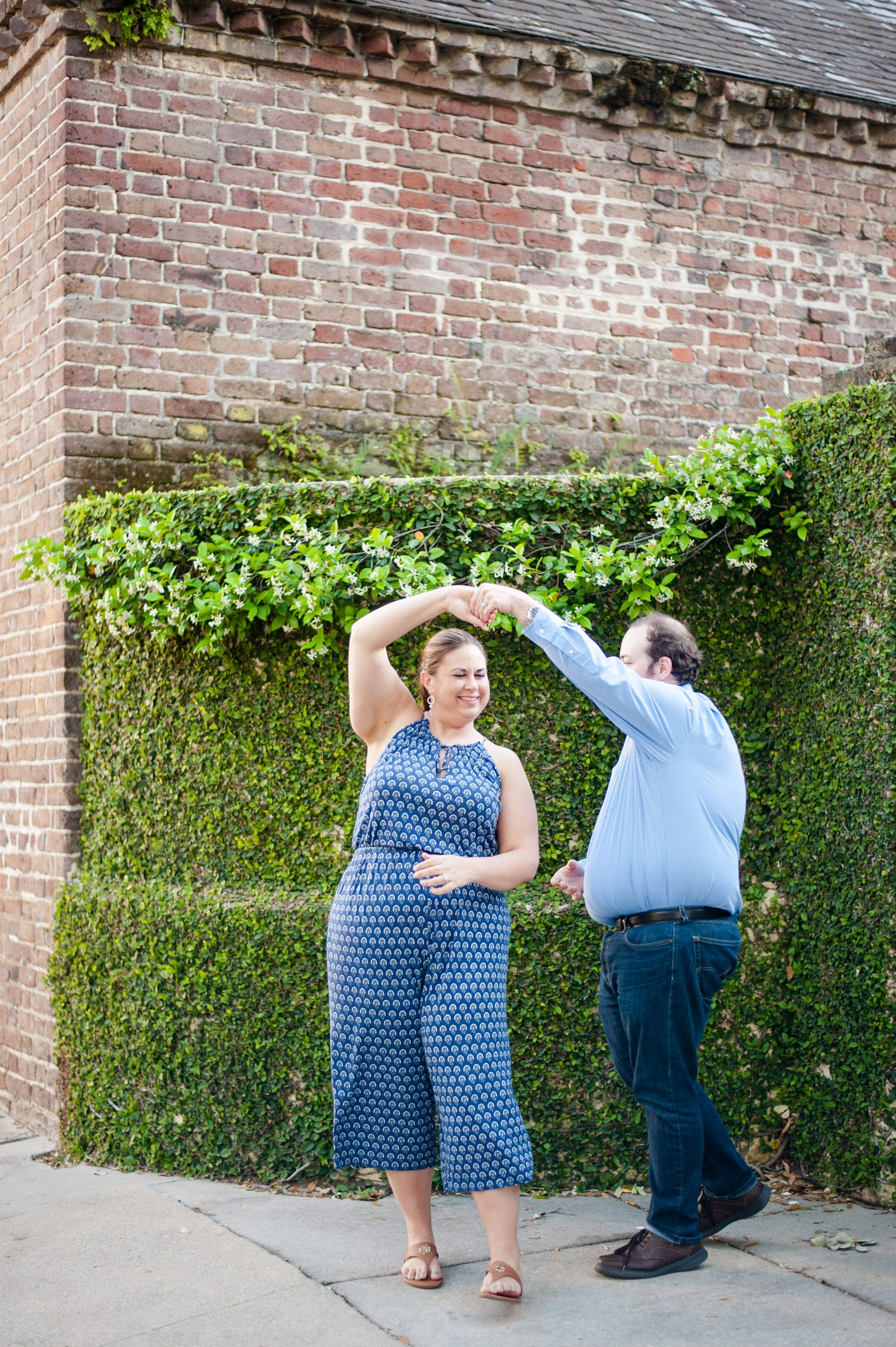 couple dances during Downtown Charleston anniversary photos