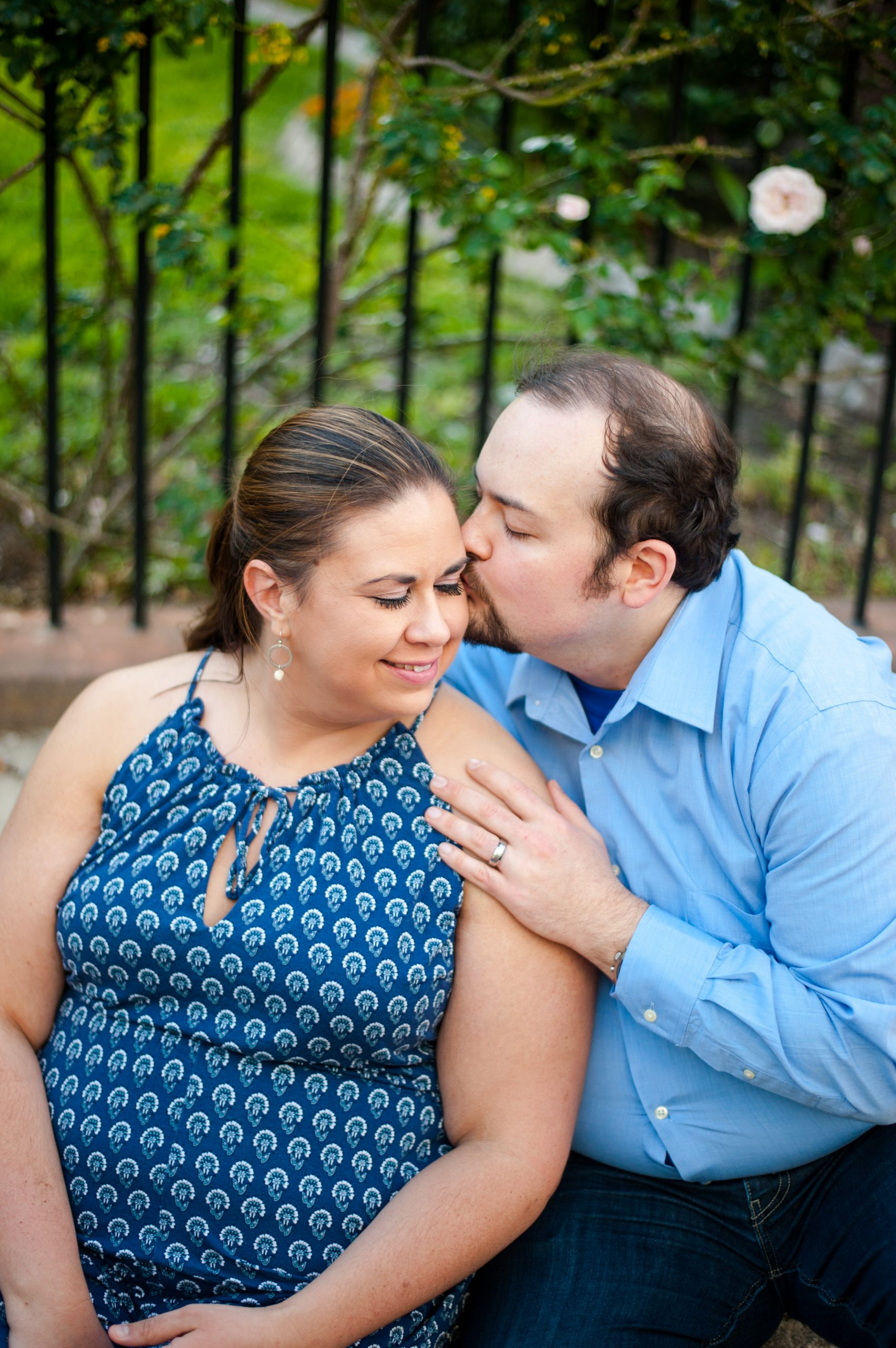 man kisses woman on forehead in downtown Charleston anniversary photos