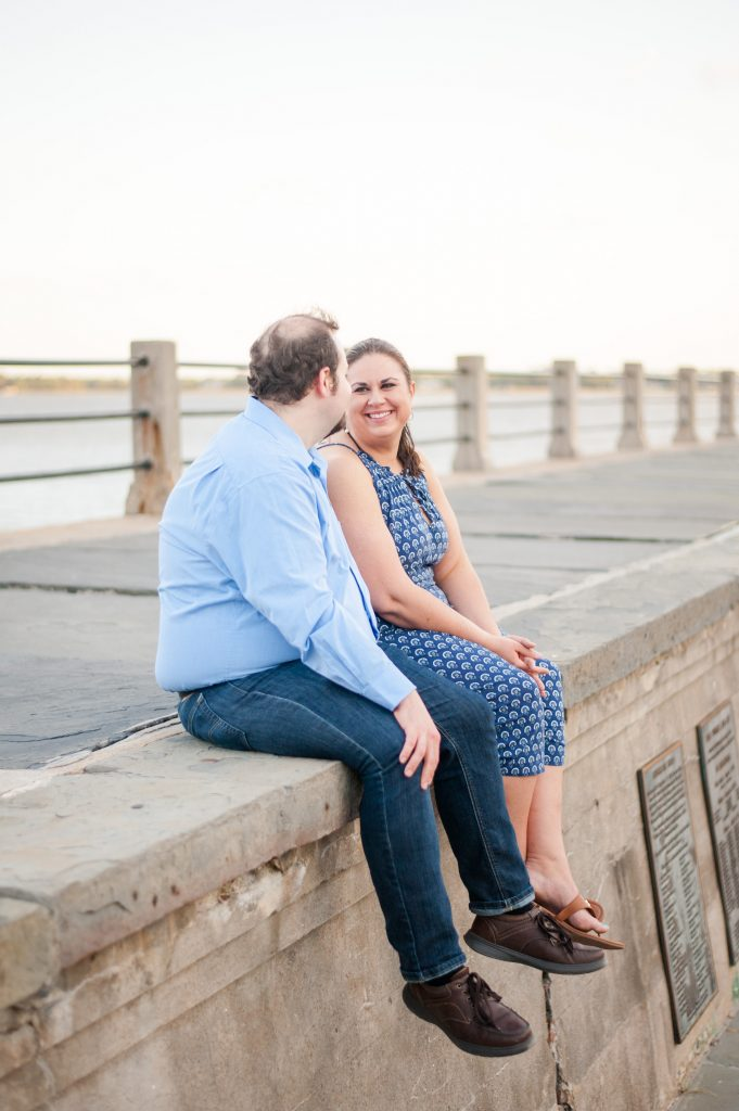 couple sitting on pier at the Battery in Downtown Charleston, SC