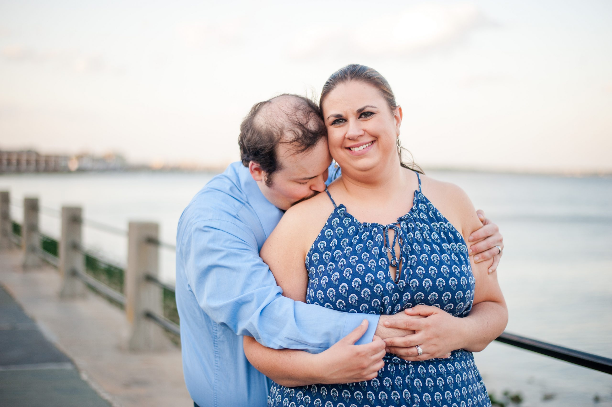Couple standing at the Battery in Downtown Charleston, SC