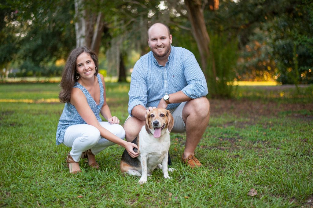Couple posing with their dog during Hampton Park family photos