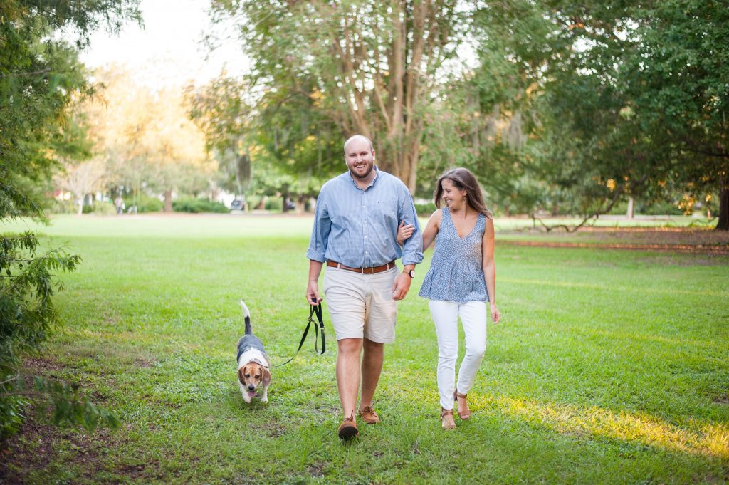 Couple walking their dog at Hampton Park in Charleston