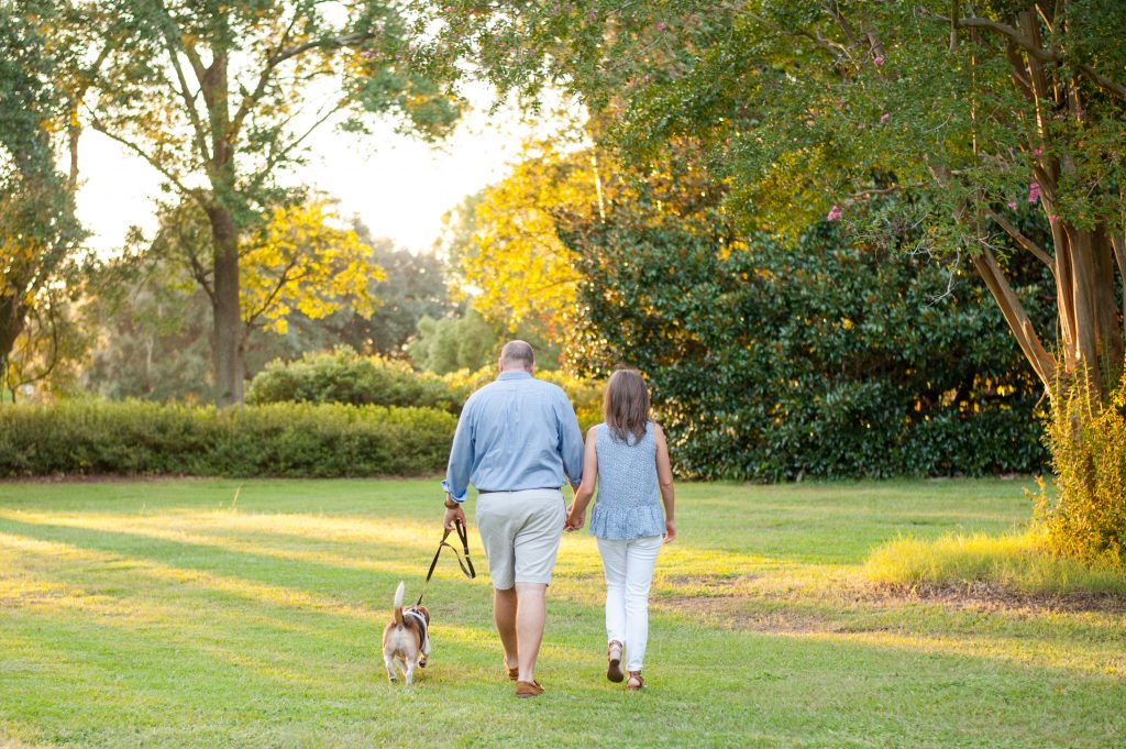 Couple walking their dog during sunset at Hampton Park