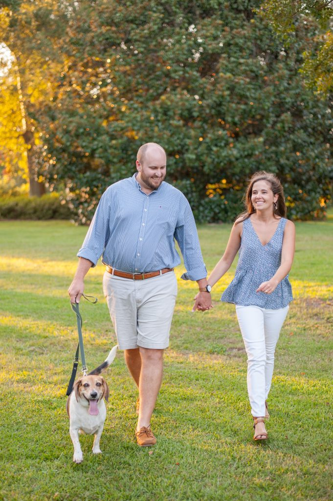 Couple walking their dog during Hampton Park portrait session