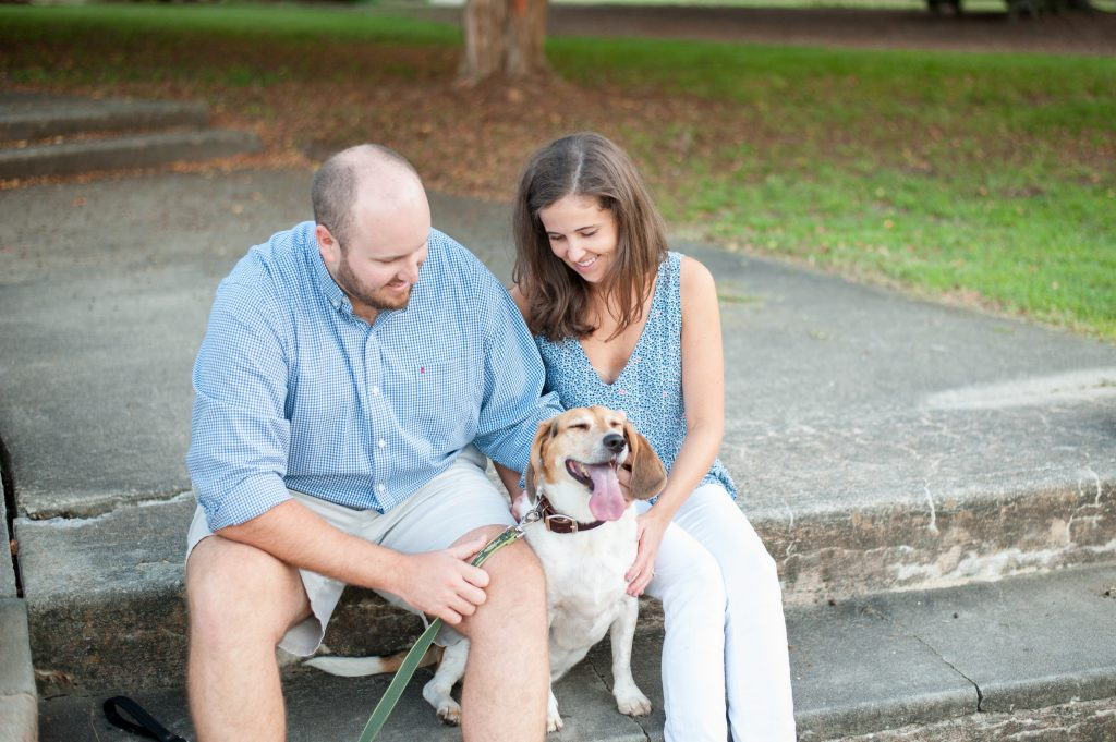 Couple plays with their dog during Hampton Park portrait session
