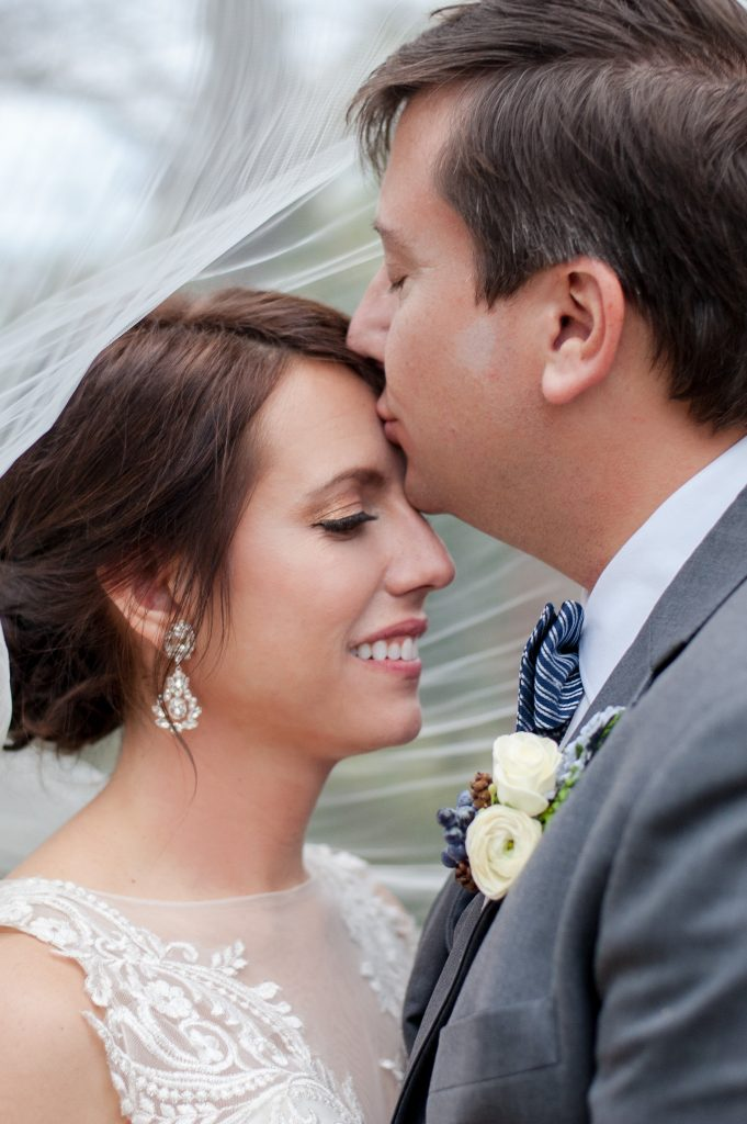 bride and groom under veil at seibels house wedding