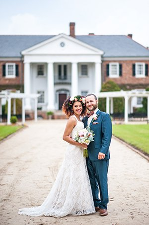 bride and groom pose for photo at Boone Hall Plantation wedding