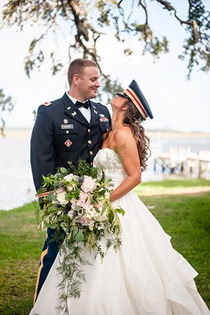 Bride wears groom's military hat on Wadmalaw Island wedding
