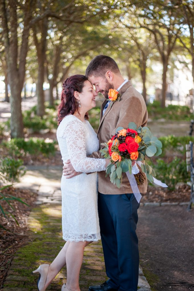 bride and groom in waterfront park in Charleston, SC after elopement