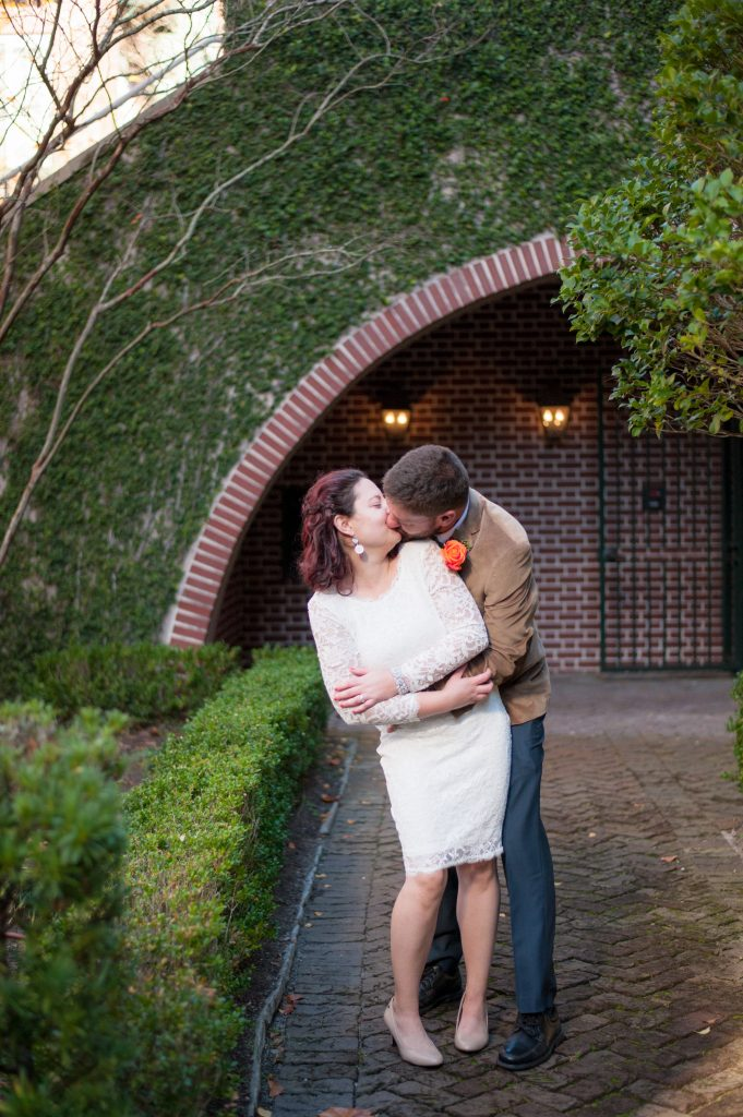 bride and groom kissing at Waterfront Park in Charleston, SC