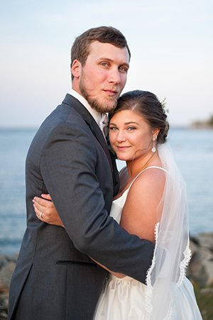 Couple looks at camera during wedding at Somerset Point