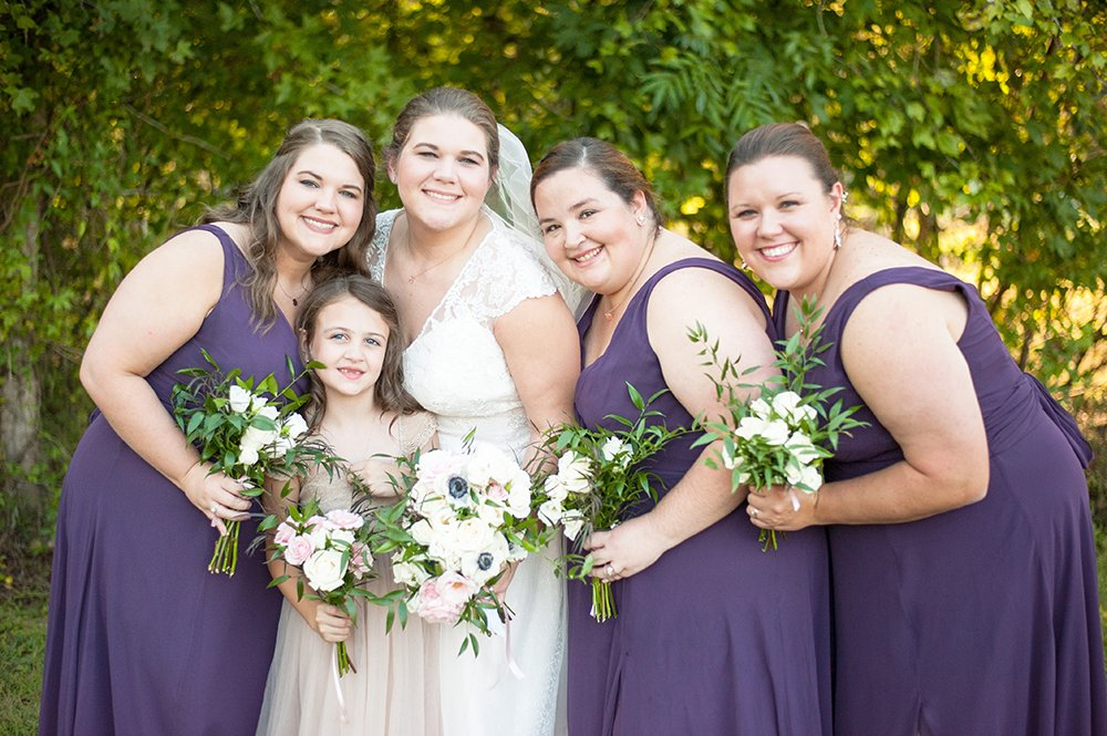 Bride and bridesmaids in purple at barn wedding in Charleston, SC