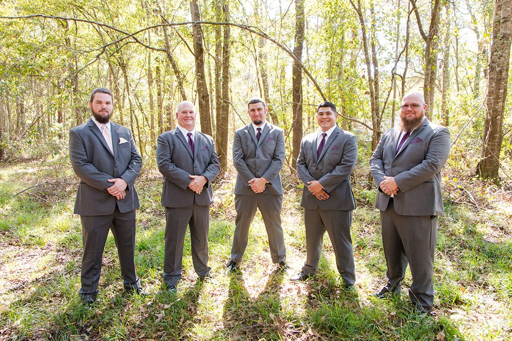 Groom and groomsmen at barn wedding in Charleston
