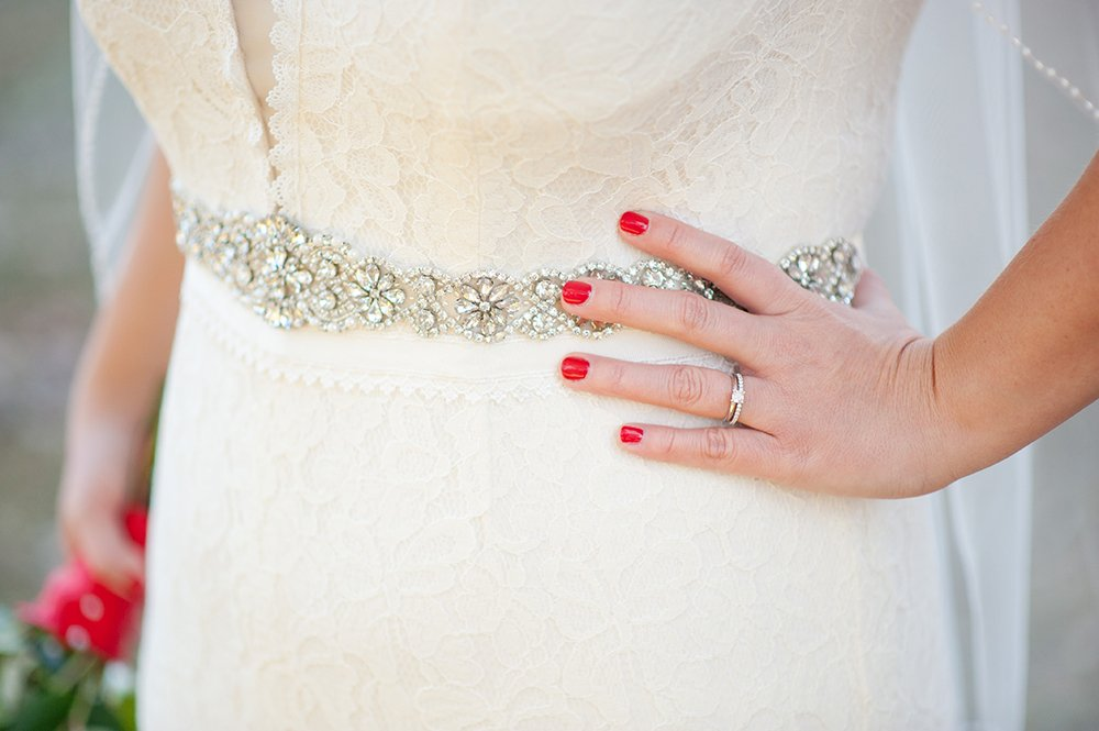 bridal details wedding rings and wedding dress belt