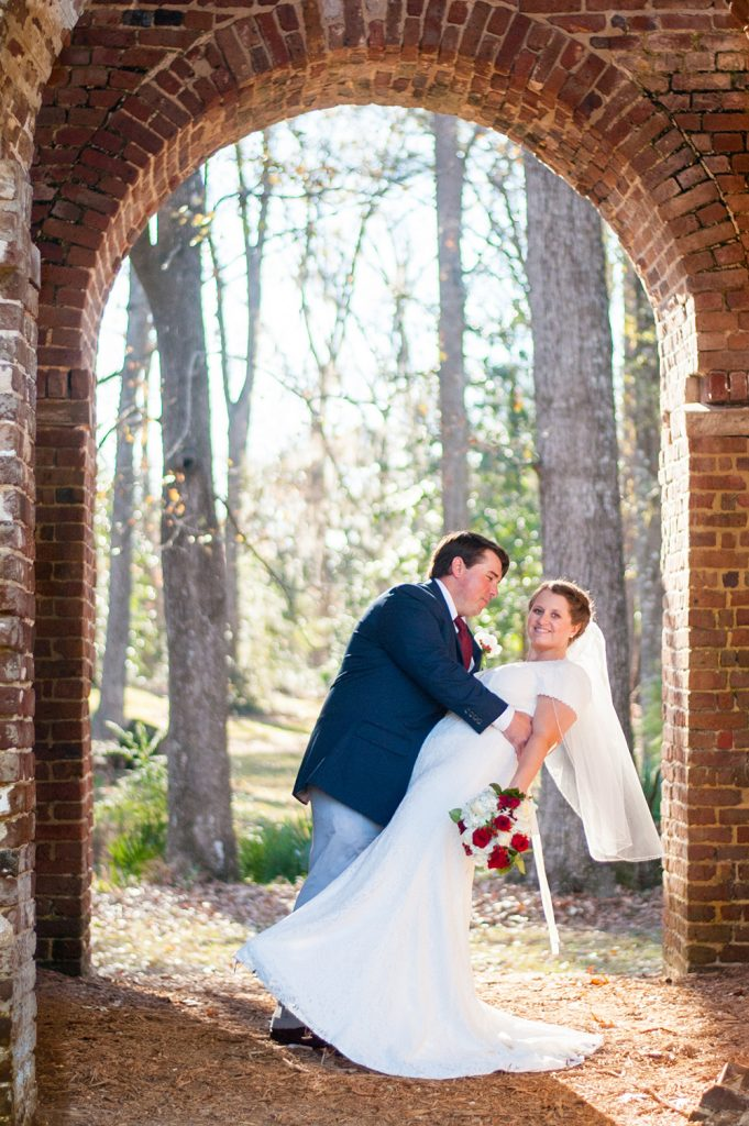 Bride and groom in front of bell tower at Colonial Dorchester State Historic Site wedding in Charleston, SC