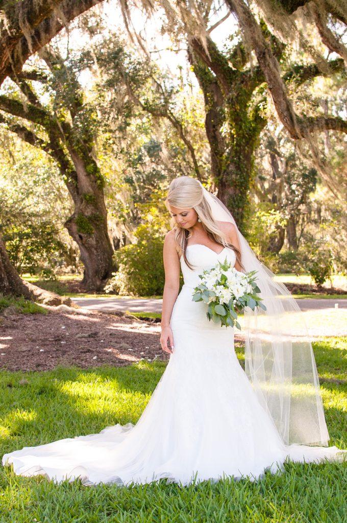 Bride under oak trees at Magnolia Plantation wedding