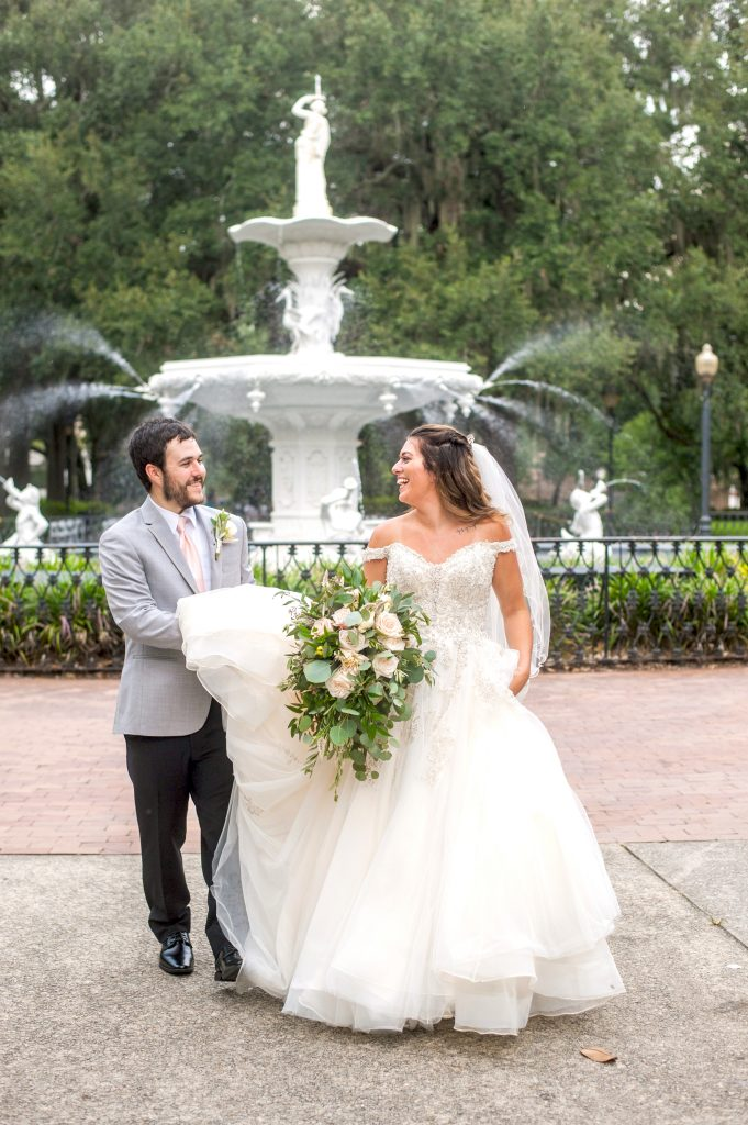 bride and groom in front of fountain at Forsyth Park in Savannah, GA