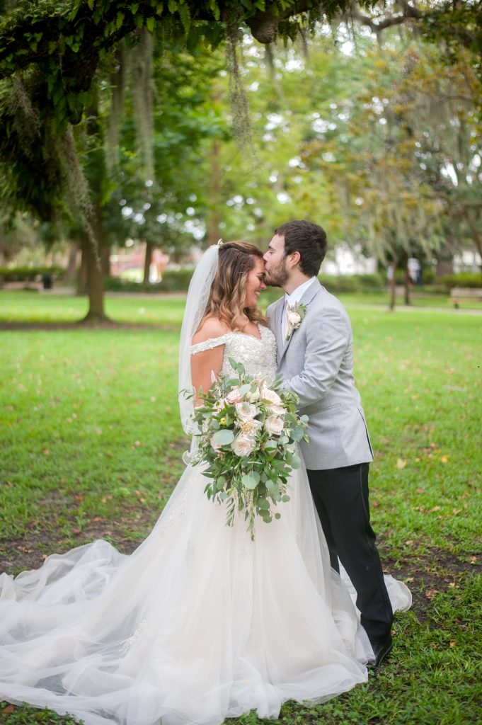 Bride and groom portraits after elopement in Forsyth Park in Savannah, GA