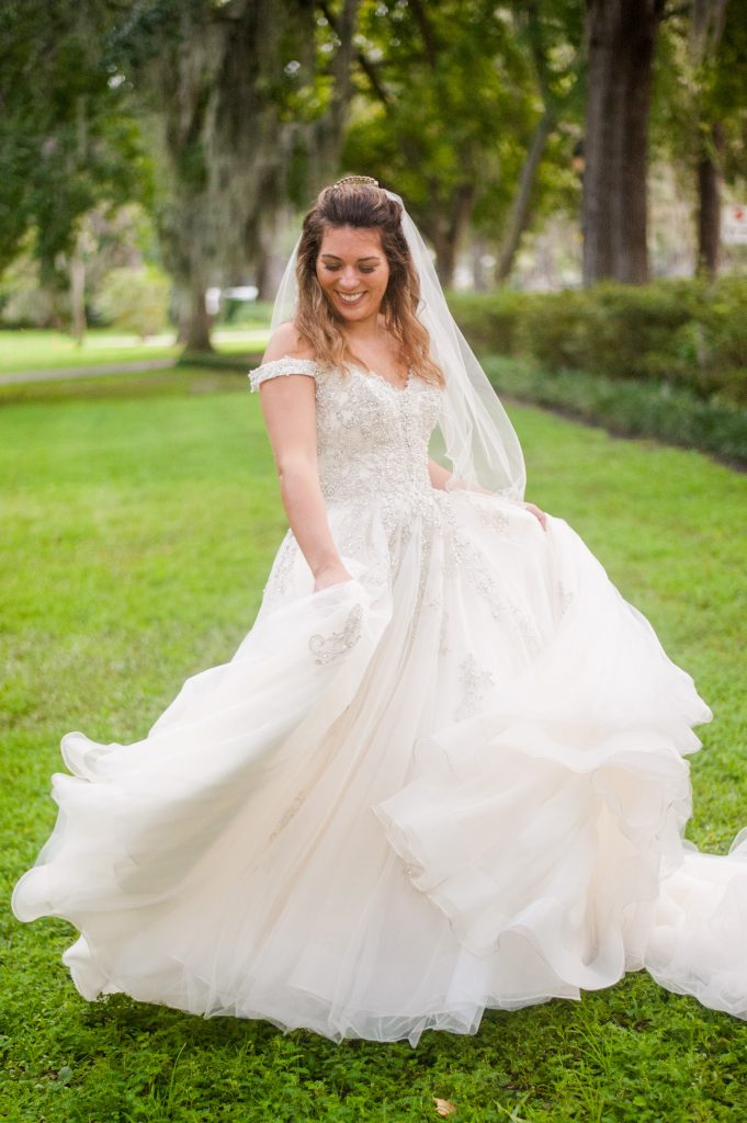 bride twirling in wedding gown in Forsyth Park in Savannah, GA