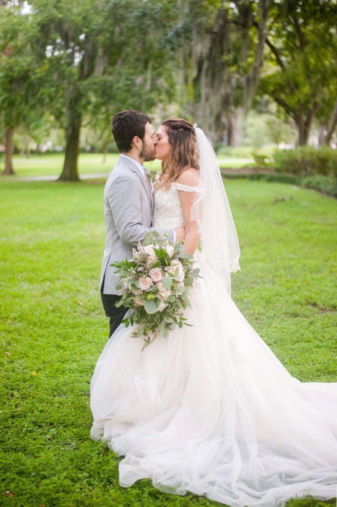 Bride and groom after elopement in Forsyth Park in Savannah, GA