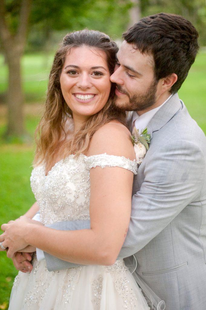 bride and groom pose at Forsyth Park wedding in Savannah, GA