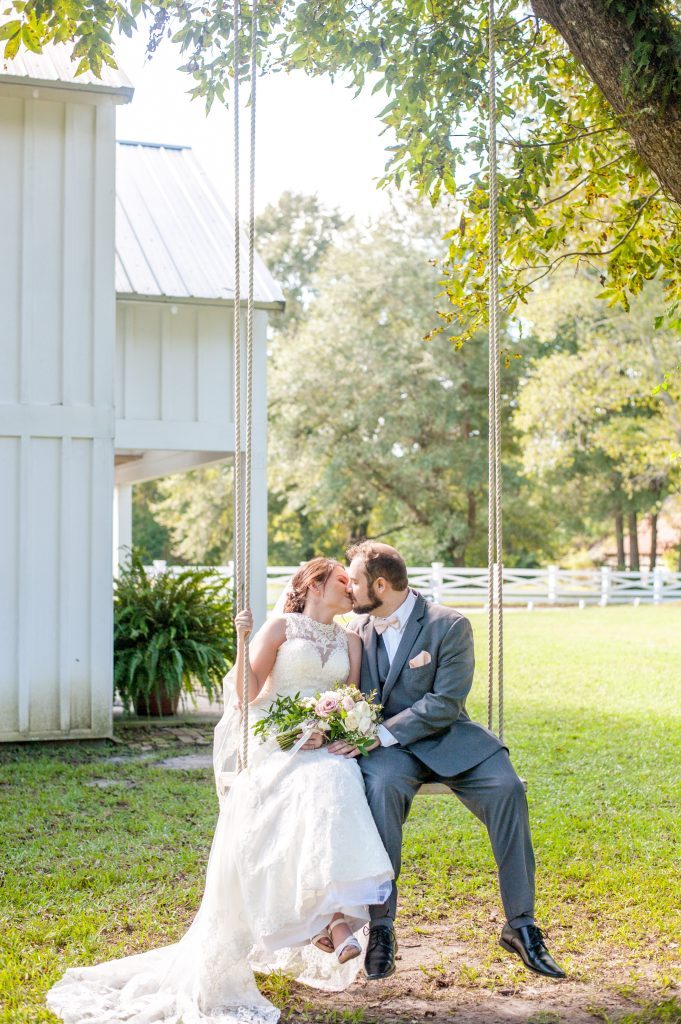 Wildberry Farm Wedding in Marion, SC couple on swing