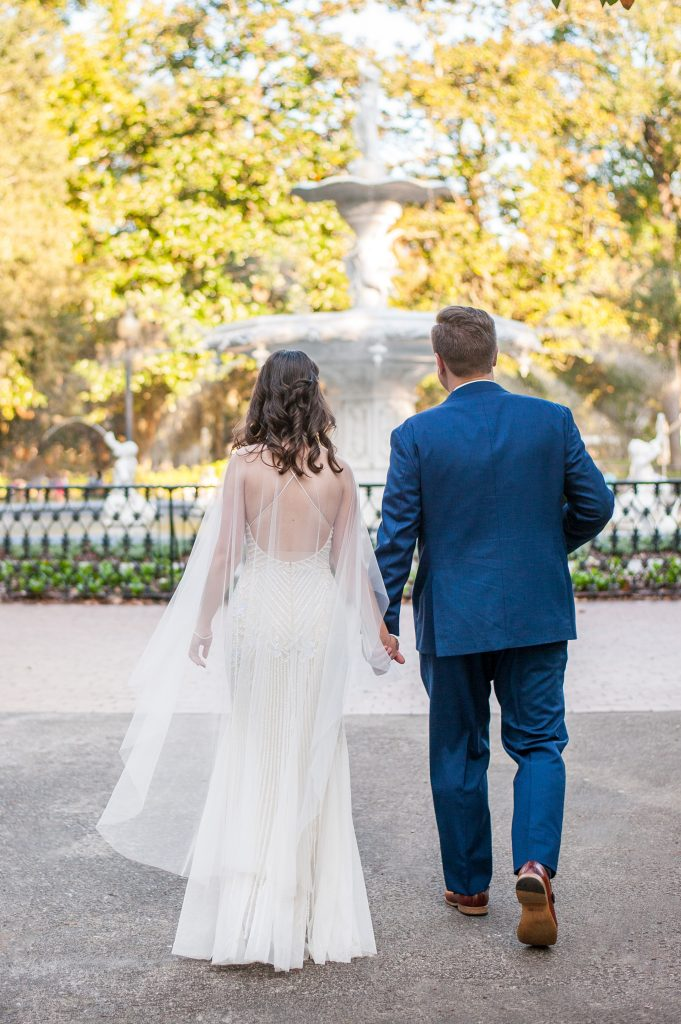 bride and groom in front of Forsyth park fountain at Savannah elopement