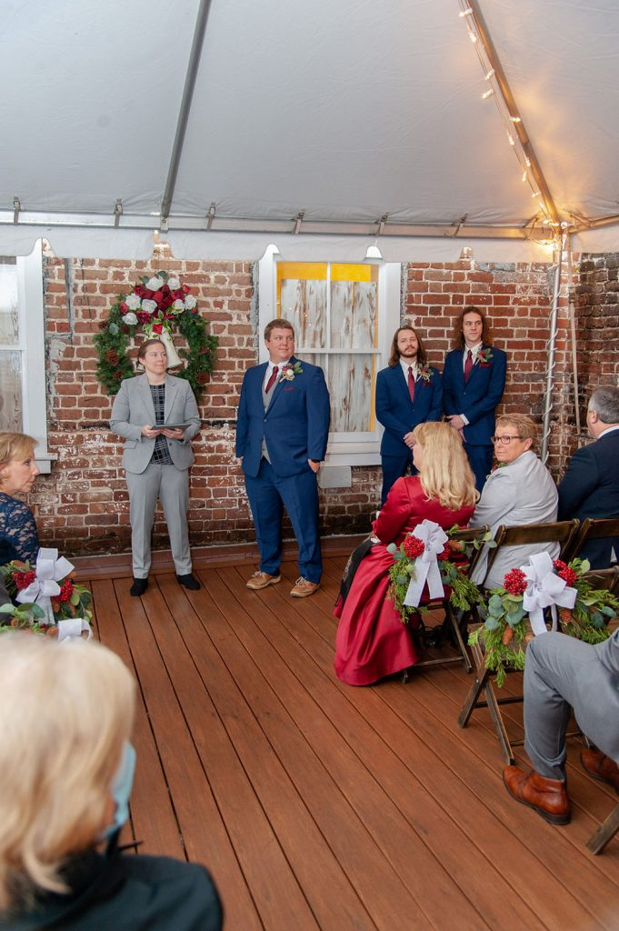 christmastime wedding ceremony at Upstairs at Midtown in Charleston, SC