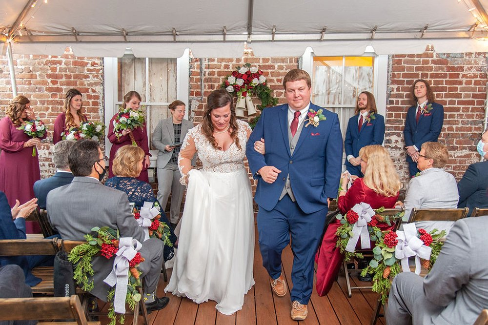 christmas time wedding ceremony at Upstairs at Midtown in Charleston, SC