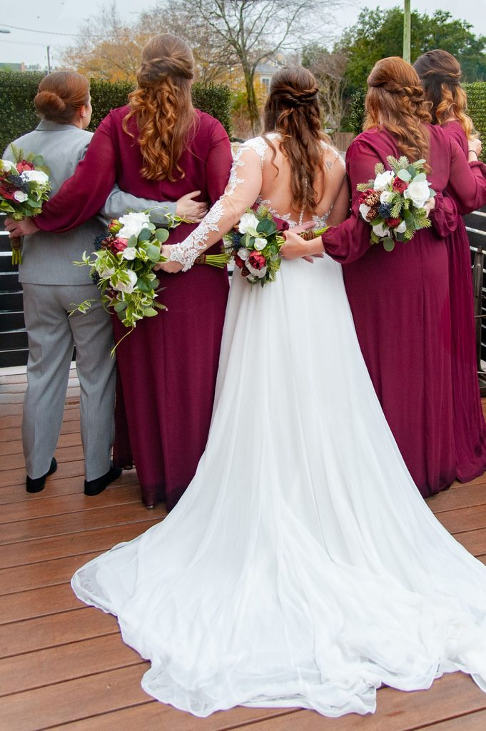 bride and bridesmaids at upstairs at midtown wedding in Charleston, SC